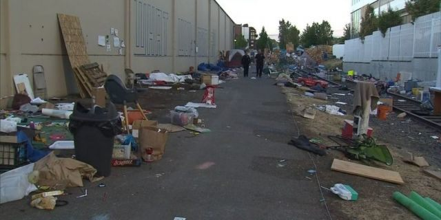 """Piles of debris awaited cleanup at an """"Occupy ICE"""" camp in Portland, Oregon, after police cleared out protesters earlier this week. (KPTV-TV/FOX 12)"""