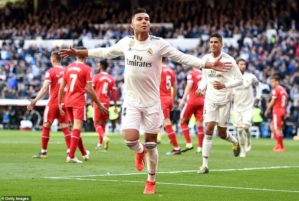 Casemiro celebrates after opening the scoring for Real, who are trying to chase Barcelona at the top of La Liga