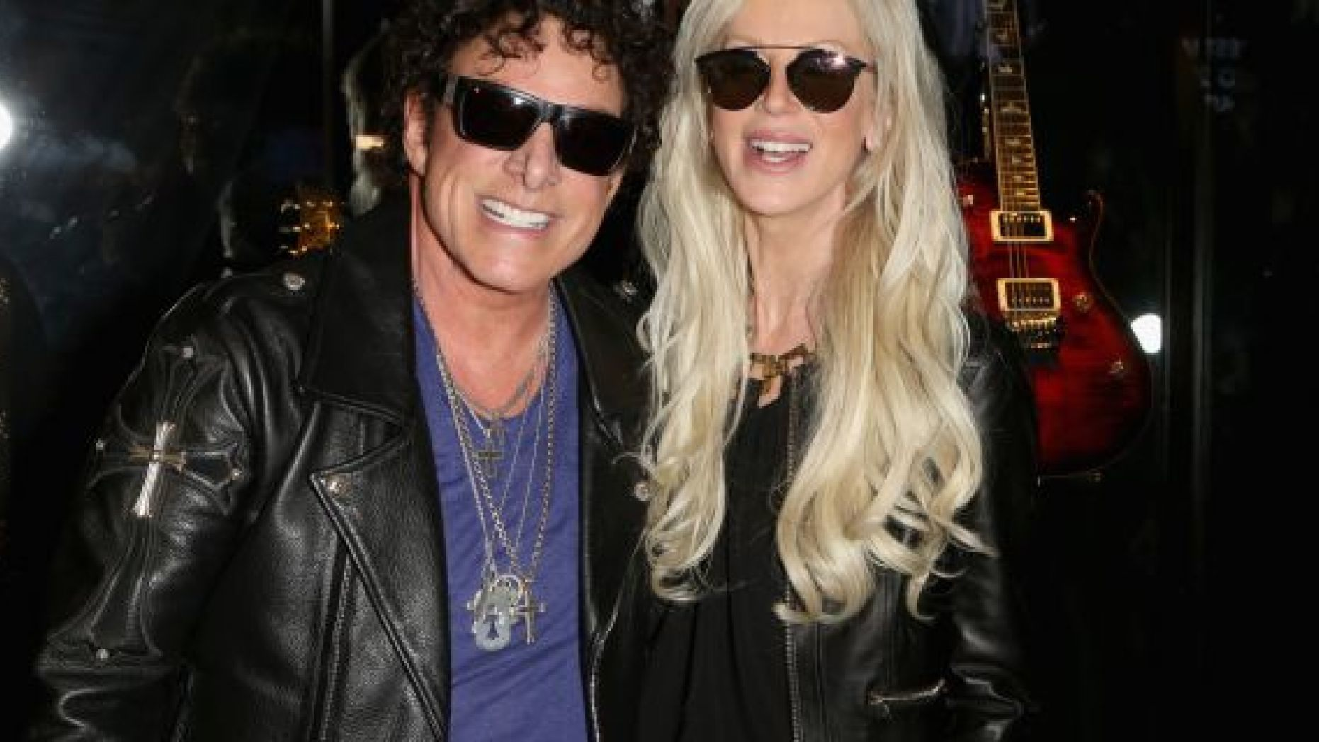 Guitarist Neal Schon (L) of Journey and his wife, television personality Michaele Schon are reportedly suing Live Nation for emotional distress.
