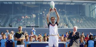 Daniil Medvedev holds aloft the Rookwood Cup after beating David Goffin in Cincinnati