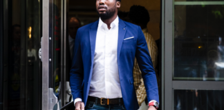 In this Aug. 6, 2019 file photo, Rapper Meek Mill departs from the criminal justice center in Philadelphia after a status hearing. Mill is due in court Tuesday to learn if Philadelphia prosecutors will drop a 2007 case that's kept him under court supervision for more than a decade.