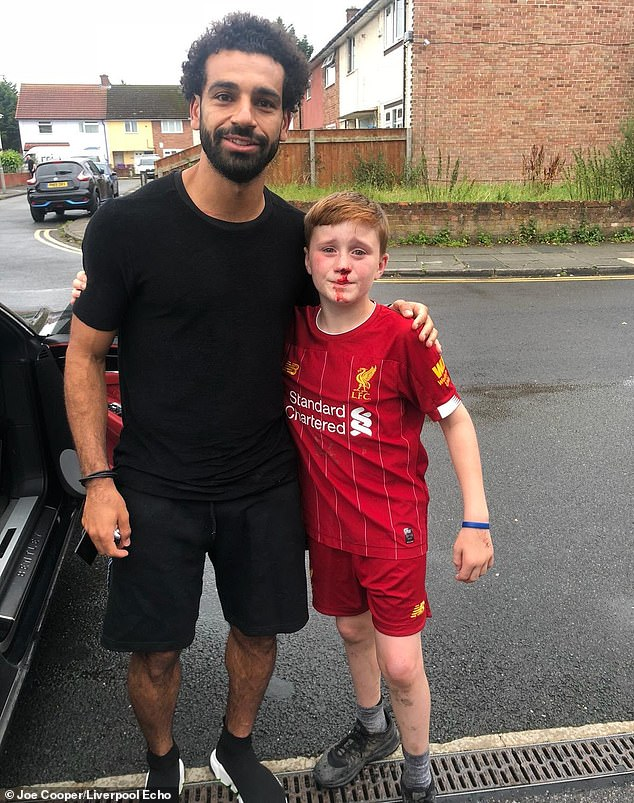 Mohamed Salah with Louis Fowler after the 11-year-old crashed into a lamppost