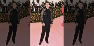 Harry Styles, in a Gucci outfit, making his Met Gala debut.