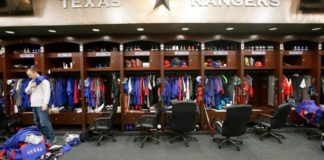 Texas Rangers pitcher Sam Dyson, left, packs a bag in the locker room at the baseball park in Arlington, Texas.
