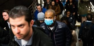 NEW YORK, NY - MARCH 09: A man wearing a protective mask is seen on a subway platform on March 9, 2020 in New York City. There are now 20 confirmed coronavirus cases in the city including a 7-year-old girl in the Bronx. (Photo by Jeenah Moon/Getty Images)