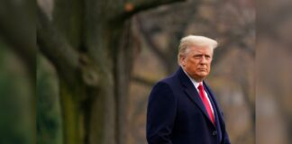 President Donald Trump walks on the South Lawn of the White House in Washington, Dec. 12, before boarding Marine One. Trump went to the Army-Navy Game at the U.S. Military Academy in West Point, N.Y. (AP Photo/Patrick Semansky)