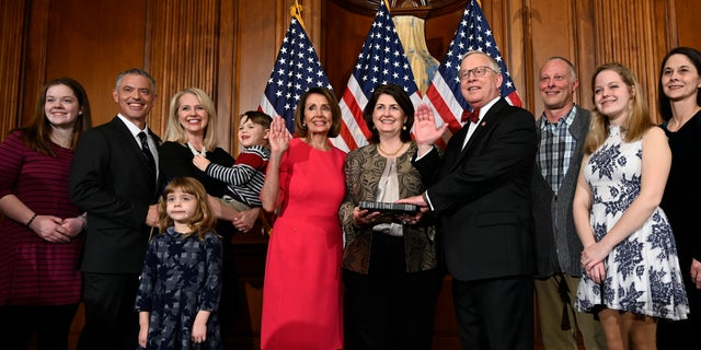 In this Jan. 3, 2019 file photo, House Speaker Nancy Pelosi of Calif., poses during a ceremonial swearing-in with Rep. Ron Wright, R-Texas, fourth from right, on Capitol Hill in Washington during the opening session of the 116th Congress. (AP Photo/Susan Walsh, File)
