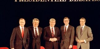 """In this Sunday, Feb. 14, 1988, file photo, Republican presidential candidates, Vice President George Bush, from left, Pat Robertson, Rep. Jack Kemp, Pierre """"Pete"""" du Pont and Senator Bob Dole pose before starting their last debate before the primary in Goffstown, N.H. Pierre S. """"Pete"""" du Pont IV, a former Delaware governor and congressman who sought the 1988 Republican presidential nomination, has died at age 86. Du Pont, a scion of the family that established the DuPont Co., died at his home in Wilmington, Del., on Saturday, May 8, 2021, after a long illness, his former chief of staff, Bob Perkins, said. (AP Photo/Jim Cole, File)"""