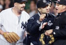 New York Yankee manager Joe Torre and pitcher David Wells argue with home plate umpire Jim Evans during the seventh inning of an American League Championship Series game at Yankee Stadium in New York. (DON EMMERT/AFP via Getty Images)