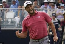 Jon Rahm celebrates making his second eagle putt in a row on the 18th green at Torrey Pines