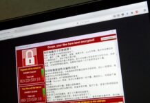 A screenshot of the warning screen from a purported ransomware attack, as captured by a computer user in Taiwan, is seen on laptop in Beijing, Saturday, May 13, 2017.