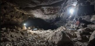Tens of thousands of bones, both animal and human, were found covering the floor of a dried-up lava tube in northwestern Saudi Arabia, which experts say was a hyena feasting ground for thousands of years
