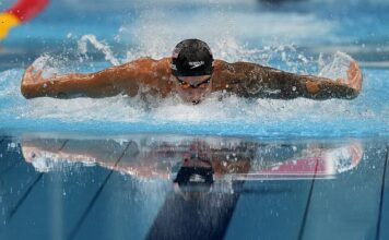 Caeleb Dressel, of the United States, swims in the men