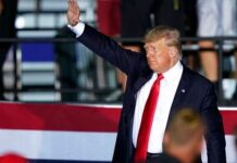 Former President Donald Trump waves to supporters as he leaves the stage after speaking at a rally at the Lorain County Fairgrounds, Saturday, June 26, 2021, in Wellington, Ohio. (AP Photo/Tony Dejak)