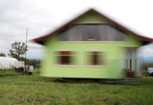 Vojin Kusic house is seen while rotating by electric motors and wheels from a military transporter