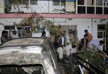 Afghans inspect damage of Ahmadi family house after U.S. drone strike in Kabul, Afghanistan, Aug. 29, 2021.