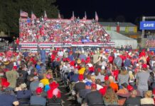 Former President Trump addresses a large crowd of supporters at the Iowa State Fairgrounds, on Saturday, Oct. 9, 2021, in Des Moines, Iowa