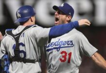 Los Angeles Dodgers catcher Will Smith, left, celebrates with pitcher Max Scherzer (31) after defeating the San Francisco Giants in Game 5 of a baseball National League Division Series Thursday, Oct. 14, 2021, in San Francisco.